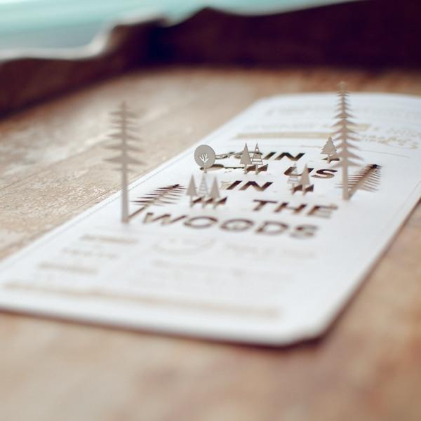 invitación de boda – Laser-cut cover stock sewn to laser-cut kraft paper.