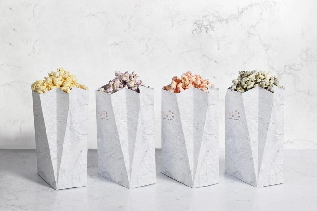 cuatro envases con textura de mármol