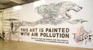 Kristopher-Ho-draws-with-Air-Ink-made-from-London-air-pollution